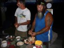 Liam prepared the fire for boiling the crabs and then James and Michael cracked the shells and removed the meat.