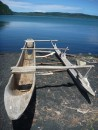 Traditional dug out canoe on the shore of the crater lake.