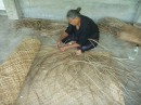 Weaving mats for export.