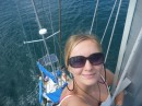 Zoe atop the mast, coming into Auckland.