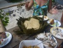 Coconut bread baked in banana leaves.