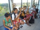 During the weekes before leaving Huahine, the students prepared a music and dance show for the class who would be receiving them. They were practising at the airport.