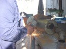 water muffler being repaired at welding shop
