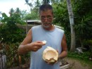 He then chopped the coconut in half, so that we could scrape out the gel like meat that was inside.