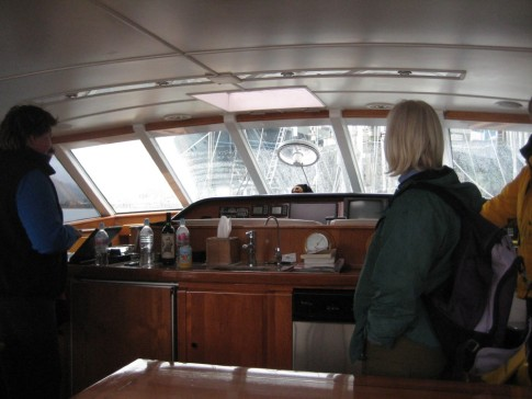 helm of superyacht showing Karen and Sherry