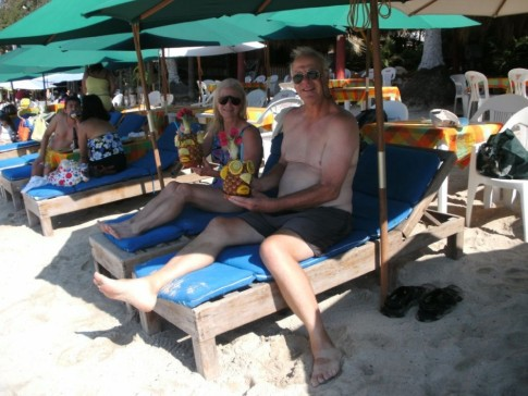 Larry and Karen with Pina Coladas served in pineapples on the Las Gatas beach