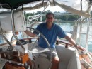 a happy Jim at the helm