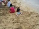 Their favorite beach activity...to cover each other in sand.