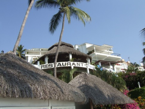 Looking up to the Paradise restaurant from the beach palapas.