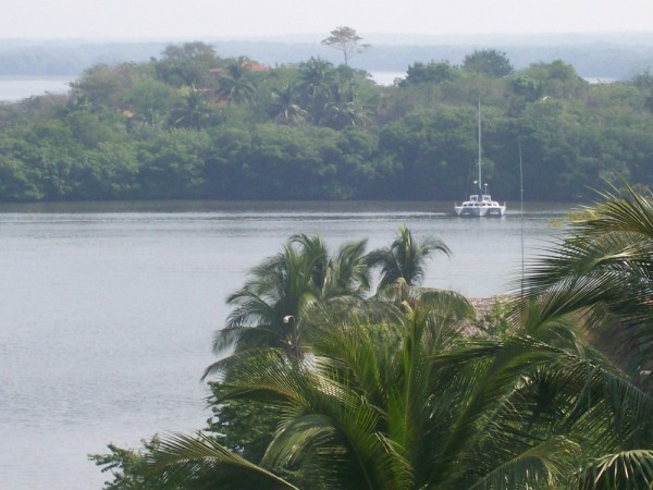 Mannasea as seen from the school. Anchored in front of the Isla in the Barra lagoon.
