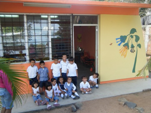 The kindergarten class with art work by Mario Tellos.