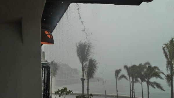 Unusual for this time of year, afternoon thunder storm on malecon in downtown Puerto Vallarta
