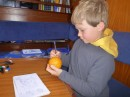 Nicky, doing his own Mercator projection on an orange peel