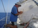 Stitching up the rip in the main sail (all Papa