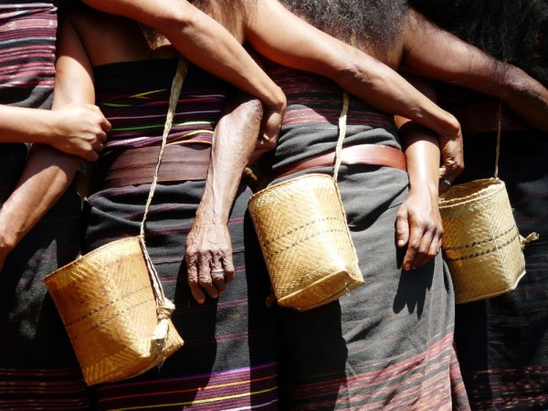 Women arm in arm demonstrating their ceremonial dance at the traditional village of Takpala