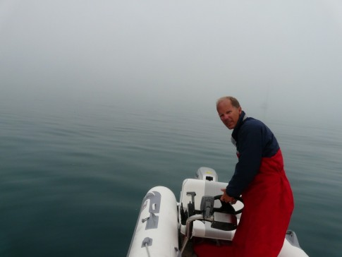 dinghy exploration in the fog