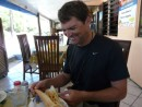 Allen inspects his Chicken Sandwich with fries, fries included inside!