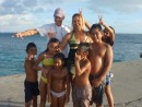 kids at Rangiroa dockside had lots of fun diving over our dinghy line