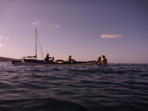 Canadian kayakers at Isla Islotes- swimming with the sea lions.  Paikea Mist in background