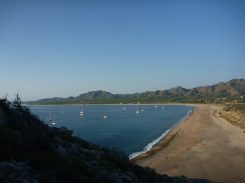 Climbing Cerro Los Frailes, our dinghy can be seen on the beach far below.