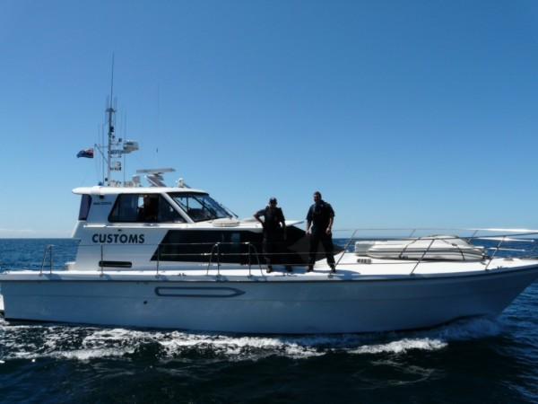 New Zealands Customs came out to see if we were okay- we were towing another Canadian vessel into Opua.