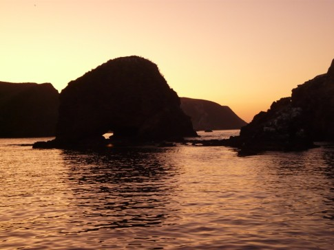 Sunset behind arch rock