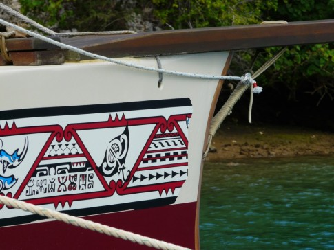 traditional designs grace the bow of the sailing canoe