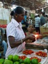 sealing small packages of food with a candel in the Labasa Market