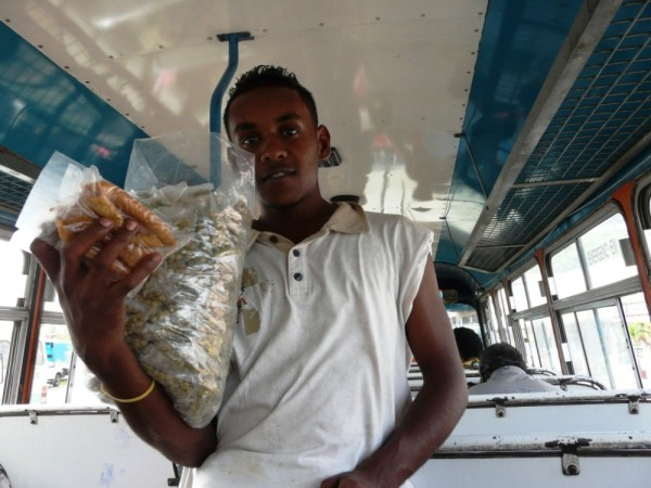 Young man selling food on the bus in Savu Savu