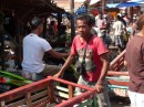 A sense of organized chaos overrides the busy market in Kupang