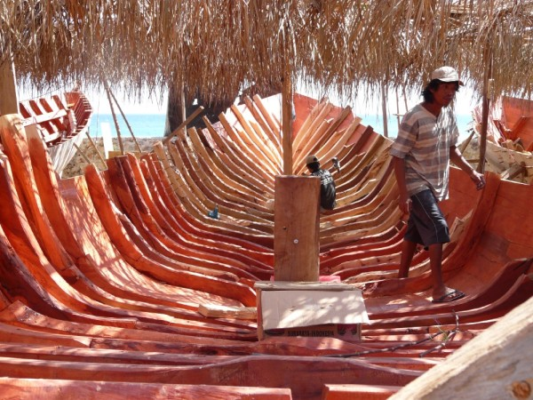 A wood boat takes shape