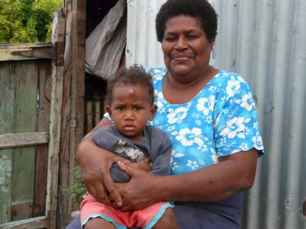 Gramma and her grandson pose for photo in the Yasawas.  She asked if we could print her the photo- a service we find ourselves doing for many people across the Pacific who don
