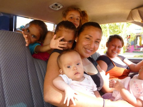 a pick up truck with no less than 6 kids, youngest is 3 months, oldest 5!