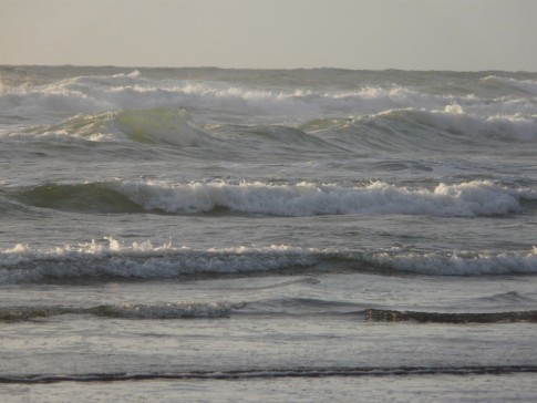 The Tasman sea breaks into Piha Beach- even locals are aware that this beach is known to have exceedingly dangerous rips.
