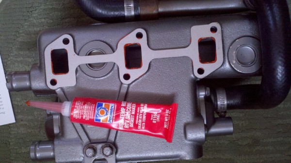 Polytex RPV liquid gasket was the ticket. Just a small bead, let it get tacky, then stick it on.