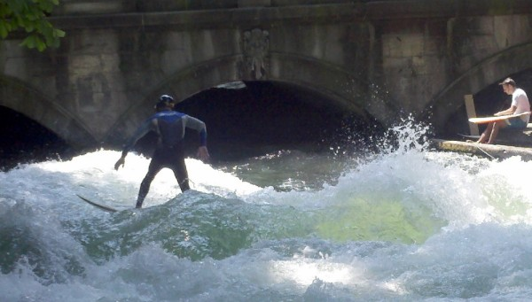 Surfers in Munich on a standing wave