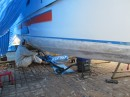 The starboard bow, fiberglassed and being faired.