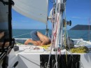 Wiring up the VHF antenna and masthead light on our way to Datai Bay.