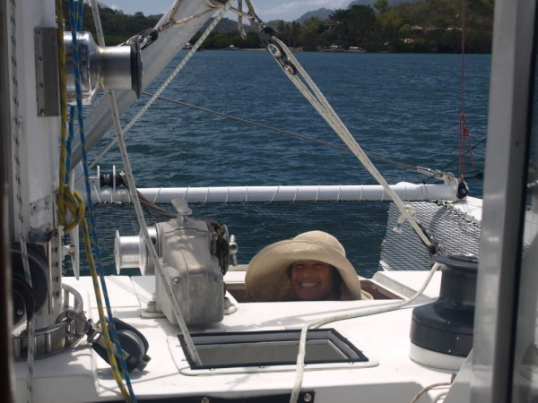 When pulling the anchor up the windlass needs a little help. Annette pulling the chain as it comes off the windlass.