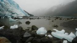 Bergy bits washed up in front of the glacier