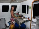 Annette making pizza in her galley on our first night at anchor.