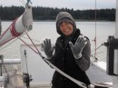 Annette finds a way to keep her hands warm and dry while pulling anchor.