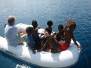 A dingy full of local kids - boy,  did they love the ride