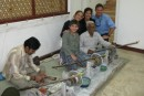Us with the artist who created our table in Agra, India