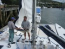 Brian and Tom getting the sails and boom off Zen in preparation for pulling the mast
