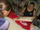 Cammi learns about silkscreening from Isa at Tropical Tease in Neiafu, Tonga