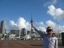 Cole leaning on the Sky Tower in Auckland.  In the photo, we are in Viaduct Harbor.