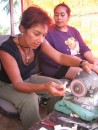 Monique carving a whales tail pendant in Tonga w/her teacher supervising (class was a birthday gift from Jaye-Jaye on s/v Blue Dawn...Thanks so much!  I loved it!!)