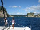 Kids on bow looking for reefs as we enter Hunga Island in Tonga