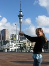 Cammi holding the Sky Tower in Auckland